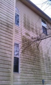 Dirty siding before being pressure washed in Charlotte, NC