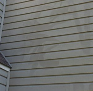 Pressure washing damage in Harrisburg, NC. Hire Camelot Pressure Washing for softwash cleaning