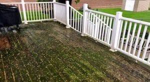 An ugly deck before pressure washing it in Harrisburg, NC